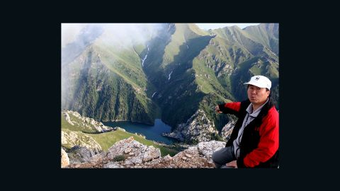 Chinese scientist and conservationist Li Weidong points to where he first discovered the Ili pika, which he named after his hometown, in 1983. Now, he says, there are none to be found here.