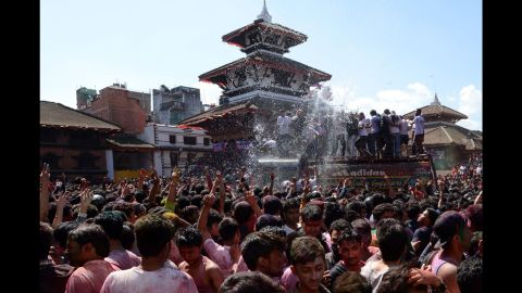 Nepalese revellers gather in celebration of the Holi festival in Kathmandu on March 5, 2015. The Holi festival of colours is a riotous celebration of the coming of spring and falls on the day of the full moon in March every year.   (Photo credit: PRAKASH MATHEMA/AFP/Getty Images)
