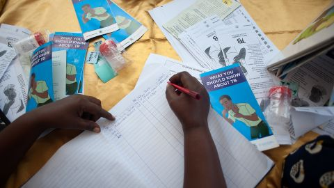 Village health teams help spread information about the signs and symptoms of TB for to help people come forward for testing. Those who do come forward are logged to ensure they received their test results.