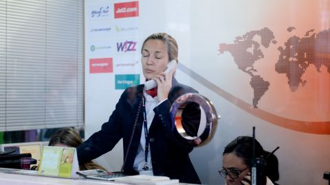 An employee of Swissport, the handling agent of Germanwings flights from Barcelona, speaks by phone at the Barcelona-El Prat Airport on March 24.