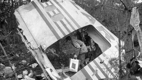 Investigators examine debris left over from the DC10 Turkish Airlines airplane crash in the Ermenonville Forest near Paris.