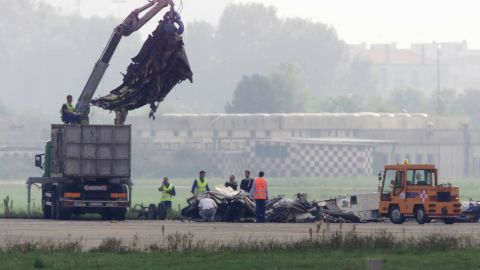 Workers remove wreckage of an MD-87 airliner that crashed at Linate Airport, near Milan, on October 8, 2001.