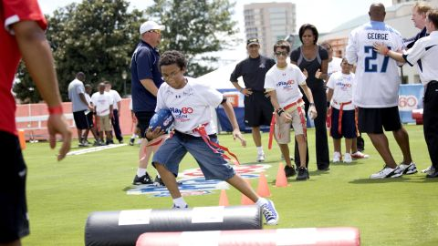 Across America, cities, towns and counties are supporting healthy afters-school programs and youth sports leagues. Here kids attend a Let's Move! event at Woldenberg Park in New Orleans in 2010. <br />