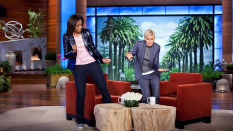 """First lady Michelle Obama and Ellen DeGeneres dance during a taping of """"The Ellen DeGeneres Show"""" marking the second anniversary of Let's Move! in Burbank, California, in 2012."""