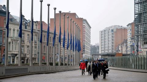 European Union flags fly at half-staff at the European Union Commission building in Brussels on March 25.
