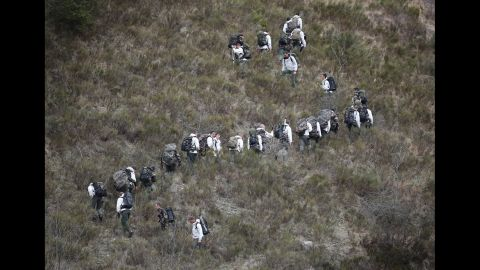 French military personnel move up a mountainside March 25 near Seyne-les-Alpes.