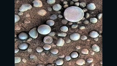 Are those Martian blueberries? These tiny spherules pepper the sandy surface in this 3-centimeter (1.2-inch) square view of the Martian surface. Opportunity took this image while the target was shadowed by the rover's instrument arm.