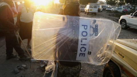 A man in Aden holds a police shield that he looted from a base belonging to forces loyal to Saleh on Thursday, March 19.