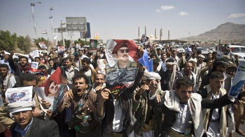 Supporters of Ahmed Ali Abdullah Saleh, the son of the former President, wave banners and shout slogans during a demonstration in Sanaa on Tuesday, March 10. The demonstrators were demanding presidential elections be held and that the younger Saleh run for office.