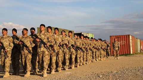 Members of the SOLI-trained Nineveh Plain Protection Units march in formation.