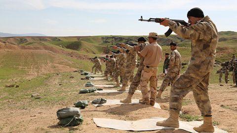 Militiamen recruits receive firing range training in Chamchamal, Iraq, from SOLI instructors.