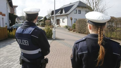 Police stand guard near the house of co-pilot Andreas Lubitz in Montabaur, Germany, on Thursday, March 26.