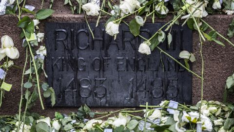 White roses adorn the statue of King Richard III before his remains were reburied Thursday, March 26, in Leicester, England. The medieval monarch's remains were found beneath a parking lot in 2012, 500 years after he was killed in the Battle of Bosworth Field.