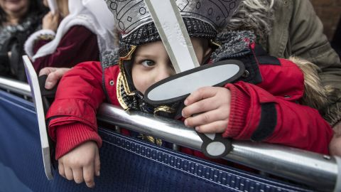 Torin Weston, 4, is dressed as Richard III as he waits with his grandmother outside Leicester Cathedral on March 26.