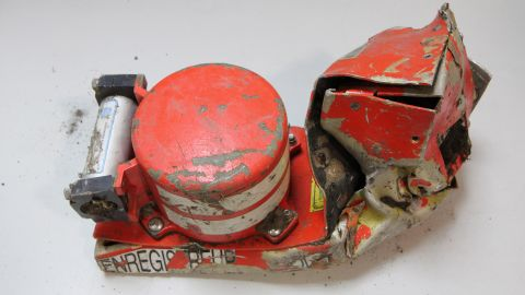 This photo provided in Paris, Wednesday, March 25, 2015 by the BEA, the French Air Accident Investigation Agency, shows the voice data recorder of the Germanwings jetliner that crashed Tuesday in the French Alps. French investigators cracked open the badly damaged black box of a German jetliner on Wednesday and sealed off the rugged Alpine crash site where 150 people died when their plane on a flight from Barcelona, Spain to Duesseldorf slammed into a mountain.