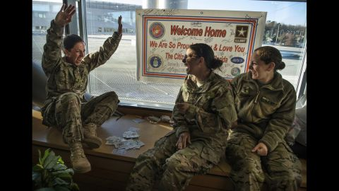 U.S. Navy Lt. Jaclyn Trosper celebrates after winning a card game on February 17, 2014, while awaiting deployment to Afghanistan.