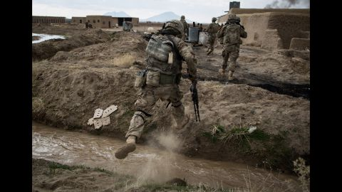 Soldiers assigned to Palehorse Troop, 4th Squadron, 2nd Calvary Regiment, traverse rough terrain in Kandahar province, Afghanistan, on February 10, 2014. The operation, a joint effort between Palehorse troops and the Afghan national army's 205th Corps Mobile Strike Force, required reconnaissance patrols in villages around Kandahar Airfield.