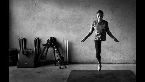Air Force Capt. Sarah Evans jumps rope in a gym in San Antonio in August. She was diagnosed with cancer while deployed in Afghanistan and was medically evacuated back to the United States, where her left leg was amputated.