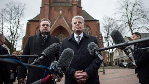 German President Joachim Gauck, alongside Haltern Mayor Bodo Klimpel, delivers a statement March 27 at a church in Haltern.