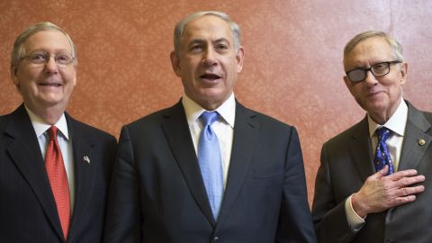 McConnell and Reid pose with Israel's Prime Minister Benjamin Netanyahu ahead of a meeting on Capitol Hill on March 3.