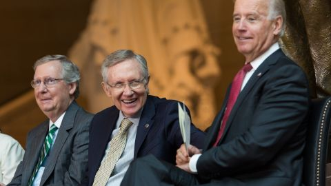 McConnell, Reid and Vice President Joe Biden laugh during a dedication ceremony for the new Frederick Douglass Statue in Emancipation Hall in the Capitol Visitor Center, at the U.S. Capitol, on June 19, 2013.
