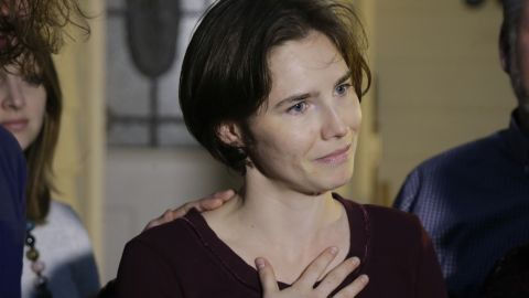 Amanda Knox talks to reporters outside her mother's home, Friday, March 27, 2015, in Seattle. Earlier in the day, Italy's highest court overturned the murder conviction against Knox and her ex-boyfriend over the 2007 slaying of Knox's roommate in Italy. (AP Photo/Ted S. Warren)