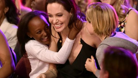 Actress Angelina Jolie hugs Zahara Marley Jolie-Pitt, left, and Shiloh Nouvel Jolie-Pitt, right, after winning award for Favorite Villain in 'Maleficent' during Nickelodeon's 28th Annual Kids' Choice Awards held at The Forum on March 28, 2015 in Inglewood, California.