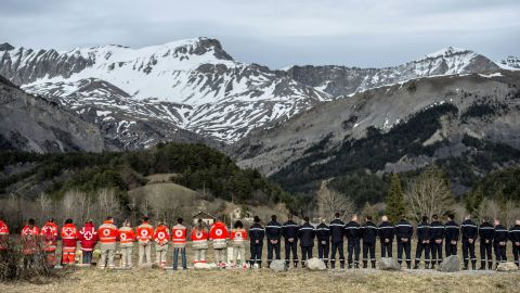 French Red Cross members and residents pay tribute to the victims at the memorial in Le Vernet on Saturday, March 28.