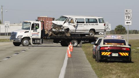 A tow truck on Monday moves the van that crashed into a canal in Glades County, Florida.