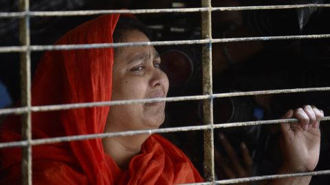 A relative of dead Bangladeshi blogger Washiqur Rahman reacts after seeing his body at Dhaka Medical College in Dhaka on March 30, 2015, after he was killed in an attack in the Bangladeshi capital. Police have arrested two men over the murder which comes just weeks after a US atheist blogger was also hacked to death in Dhaka, a crime that triggered international outrage, the officer said. AFP PHOTO/Munir uz ZAMANMUNIR UZ ZAMAN/AFP/Getty Images
