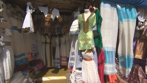 Addis also finds inspiration in the colorful local markets. Ethiopian-made scarves are a popular export, and she likes to sometimes use them as a base for her dresses.