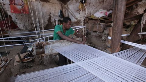 Fabrics are mostly woven by men, who use their hands and feet to create their rich tapestries.