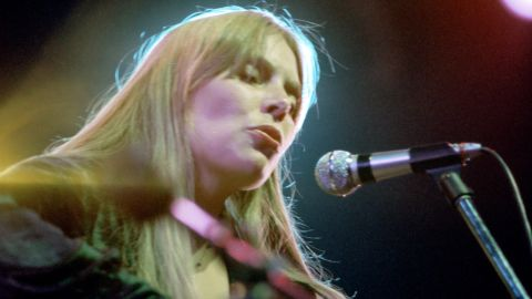 """The Canadian singer performs in an undated photograph. She was inducted into the <a href=""""https://rockhall.com/inductees/joni-mitchell/"""" target=""""_blank"""" target=""""_blank"""">Rock and Roll Hall of Fame</a> in 1997."""