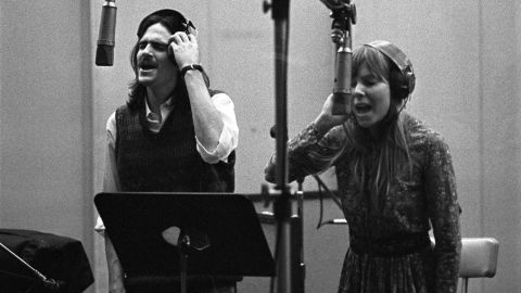 """James Taylor and Mitchell provide backing vocals for Carole King's famous """"Tapestry"""" album at A&M Records studio in Los Angeles in 1971."""