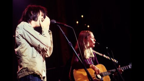 """Neil Young and Mitchell team up with the Band during """"The Last Waltz"""" concert in 1976 in San Francisco. Director Martin Scorsese documented these performances in a 1978 film."""