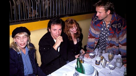 Mitchell, Bruce Springsteen, Patti Scialfa and Sting hang out at a post-concert party in 1991 in Los Angeles.
