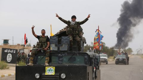 On April 1, Shiite militiamen celebrate the retaking of Tikrit, which had been under ISIS control since June. The push into Tikrit came days after U.S.-led airstrikes targeted ISIS bases around the city.