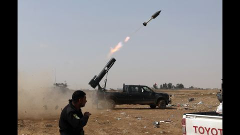 Iraqi security forces launch a rocket against ISIS positions in Tikrit on Monday, March 30.