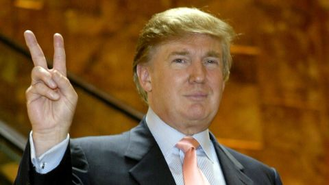 """Trump arrives at """"The Apprentice"""" casting call in Trump Tower on July 30, 2004, in New York City."""