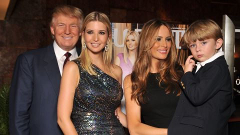 """Trump, his daughter Ivanka, wife Melania and son Barron attend the """"The Trump Card: Playing to Win in Work and Life"""" book launch celebration at Trump Tower on October 14, 2009, in New York City."""