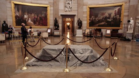 """A plastic sheet shrouds <a href=""""http://www.aoc.gov/nations-stage/catafalque"""" target=""""_blank"""" target=""""_blank"""">the catafalque</a>, or platform, originally built to support the casket while the President lay in state in the U.S. Capitol Rotunda. It has been used often for dignitaries and elected officials since. Here, it is prepared for honors to former President Gerald Ford in December 2006. The catafalque is normally displayed in the Exhibition Hall at the <a href=""""http://www.visitthecapitol.gov/"""" target=""""_blank"""" target=""""_blank"""">U.S. Capitol Visitor Center</a>. The black drapery on top of the wooden platform has been changed several times over the years."""
