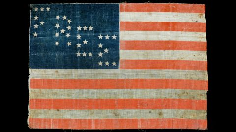"""A flag with stars spelling out the word """"Free"""" was attached to a sandwich vendor's cart at Lincoln's funeral. The flag and medallions from Lincoln's hearse are part of the """"<a href=""""http://www.illinois.gov/alplm/tenthanniversary/Pages/FiendishAssassination.aspx"""" target=""""_blank"""" target=""""_blank"""">A Fiendish Assassination</a>"""" exhibit at the Abraham Lincoln Presidential Library and Museum in Springfield, Illinois."""