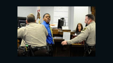 Kamron Taylor is restrained after being found guilty of murder in February in Kankakee.