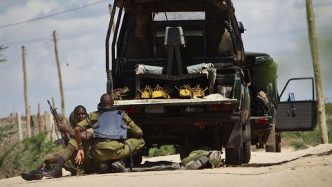 Kenyan soldiers take cover as shots are fired in front of the university on April 2, 2015.