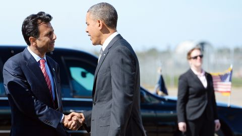 Jindal greets President Obama at Louis Armstrong International Airport in New Orleans on November 8, 2013.
