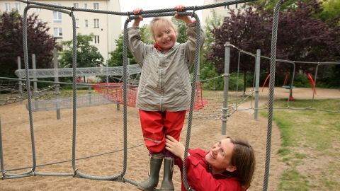 BERLIN, GERMANY - JUNE 06:  A mother plays with her three-year-old daughter on a playground on June 6, 2012 in Berlin, Germany. The Betreuungsgeld (child care subsidy), proposed to take effect in January 2013, would give parents that keep their children at home instead of sending them to a kindergarten €150 per child per month, causing concern amongst critics who feel that the state support would foster traditional family values as well as provide an incentive for low-income families to keep their children at home. The government has meanwhile planned to guarantee the right to placement in a Kindergarten from August 2013.  (Photo by Adam Berry/Getty Images)