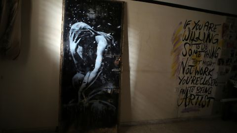 """A mural of a weeping woman, painted by the British street artist Banksy, is seen in Khan Yunis, Gaza, on Wednesday, April 1. The mural was painted on a door of a house destroyed last summer during the fighting between Israel and Hamas. The owner of the house <a href=""""http://edition.cnn.com/2015/04/02/middleeast/gaza-war-door-banksy-artist/index.html"""" target=""""_blank"""">said he was tricked into selling the door</a> for the equivalent of $175, not realizing the painting was by the famously anonymous artist."""