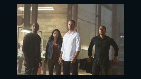 """Walker with Tyrese Gibson, Michelle Rodriguez and Ludacris in """"Furious 7,"""" which had mostly completed filming when Walker died.  Many fans got emotional upon seeing Walker onscreen in the movie, which earned $143 million its first weekend."""