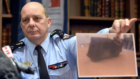 French Gen. David Galtier holds up a picture of the second black box from Germanwings 9525 during a news conference in Marseille, France, on Thursday, April 2. The flight data recorder shows that co-pilot Andreas Lubitz purposely used the controls to speed up the plane's descent, investigators said.