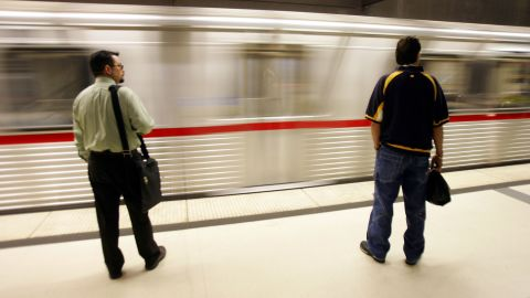 Slumped over on the train during your commute? It can cause neck and back pain.